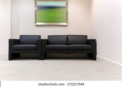 Black leather chairs in a modern office waiting room
