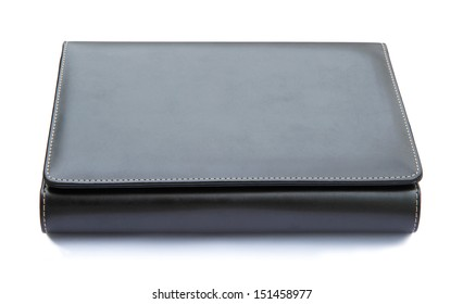Black leather cover notebook isolated on white background