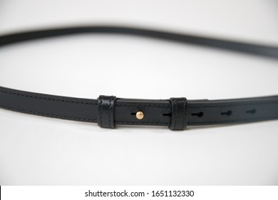 Black leather fastening belt, strap isolated on white background - Image