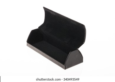 An black leather glasses case opened isolated white.