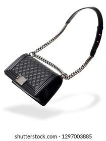 Black leather handbag on white background. Luxury accessory