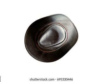 Black leather hat isolated on white background. Top view. Cowboy black hat decorated with a brown coiled cord