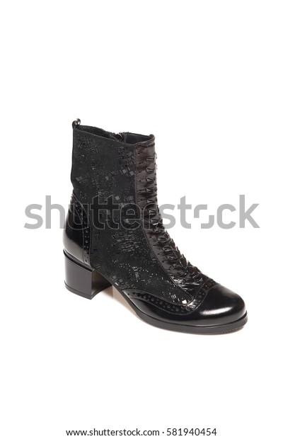 Black leather high boot isolated on white background