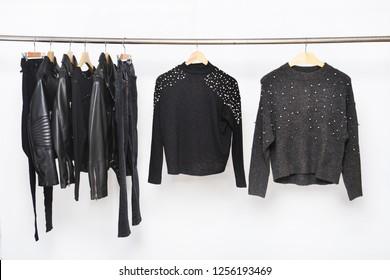 black leather jacket and rivets black jacket,pants,shirt on hanger