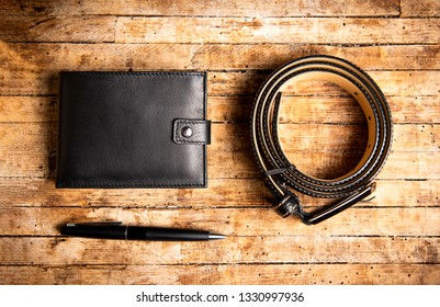 Black leather male accessories set of wallet belt and pencil top view