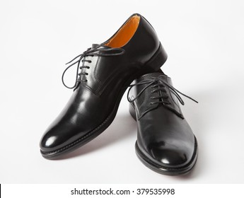 Black leather male shoes, white background