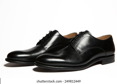 Black leather men's shoes isolated on white background