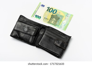 black leather men's wallet and 100 euros on a white background