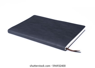 Black leather notebook isolated on white background. Lighting in the studio