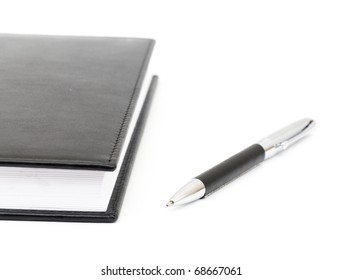black leather Notebook and pen. isolated on white