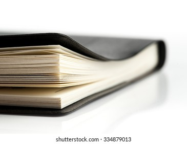 Black leather notebook ,Selective focus with shallow depth of field.
