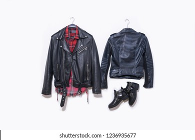 black leather punk jacket ,jeans with checkered shirts , on hanging with shoes