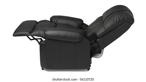 Black leather recliner armchair with massage and foot rest in reclined position, isolated on white.