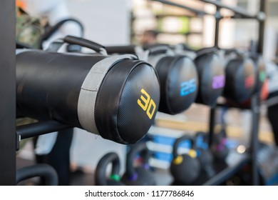 Black Leather Sacks and Dumbbells in Gym: Weight Fitness Equipment.