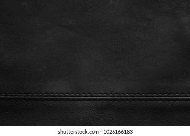 Black leather with seam as a background
