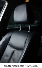 Black leather seat in a car cabin