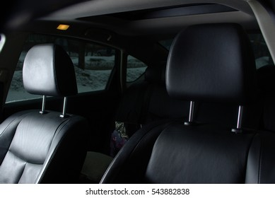 Black leather seats insude a car cabin