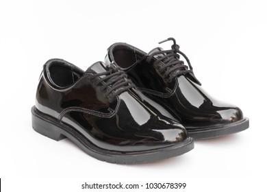 Black leather shoes isolated on white background