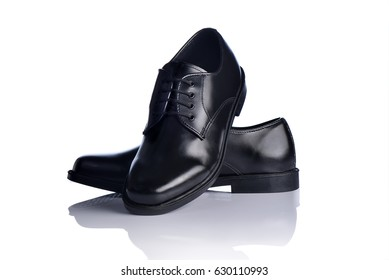 Black leather shoes for men on white background.