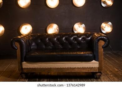 Black leather sofa in cool loft interior