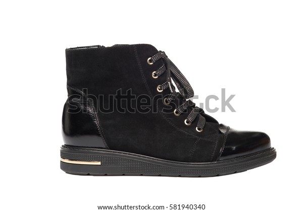 Black leather suede high boot isolated on white background