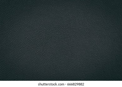 Black leather texture as background.
