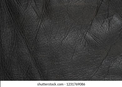 Black leather texture background close up