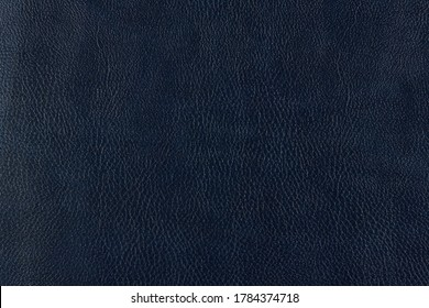 Black  Leather texture close up as background. The material for the manufacture of leather goods