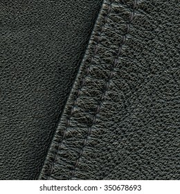 black leather texture decorated with seam closeup