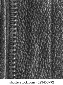 black leather texture decorated with a zipper closeup
