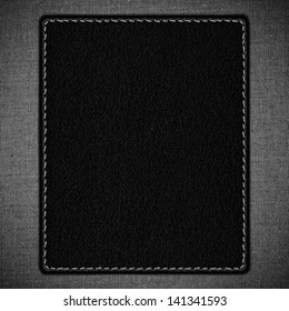 black leather texture with white seam on linen grid pattern background