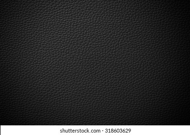 Black leather textured background with vignette effect.