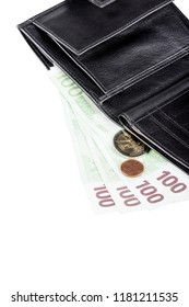 Black leather wallet with euro banknotes and coins, isolated on white background