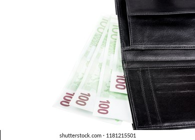 Black leather wallet with euro banknotes , isolated on white background