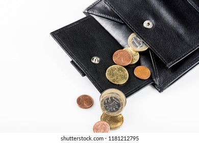 Black leather wallet with euro coins, isolated on white background