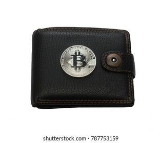 black leather wallet and silver metal bit coin isolated