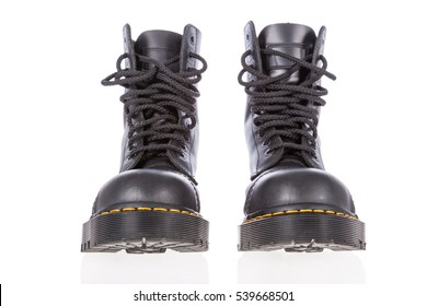 Black leather work boots with steel toe and military style isolated on white background.