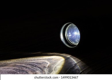 black led operational flashlight on rough wooden surface - closeup with selective focus