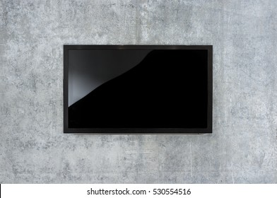 Black LED tv television mockup, blank on gray concrete background