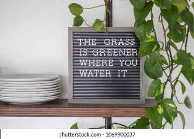black letterboard inspirational quote the grass is greener