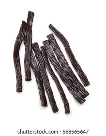 Black licorice candies isolated on white background