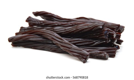 Black licorice candies isolated on white background