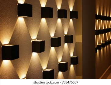black light in the form of a cube on the wall, perspective, yellow light, a graphic pattern of light.