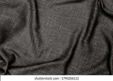 Black linen fabric texture. Crumpled cloth textile background. Draped raw organic cloth black pattern