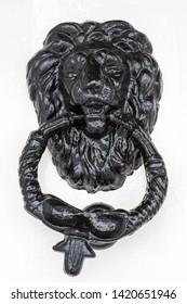 Black Lion door bell on white background