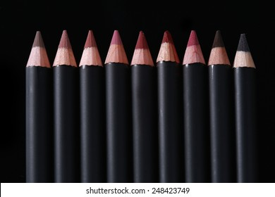 Black Lip Liner Pencils on Black Background