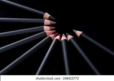 Black Lip Liner Pencils on Black Background