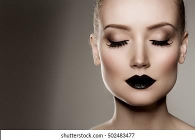 Black lips. Halloween Makeup. Luxury beautiful woman with dark lipstick. Beauty stylish girl with closed eyes