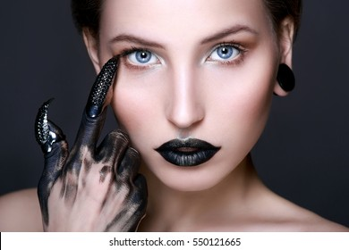 Black lips. Halloween Makeup. Luxury beautiful woman with dark lipstick and claws. Beauty stylish girl with closed eyes