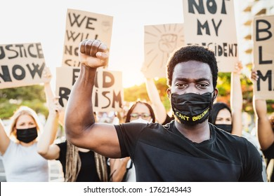 Black lives matter activist movement protesting against racism and fighting for equality - Demonstrators from different cultures and race protest on street for justice and equal rights  - Shutterstock ID 1762143443